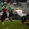HALEY WARD | THE GOSHEN NEWS <br /> Concord wide receiver Cedric Mitchell evades the tackle by Wawasee safety Rylan Kuhn to return a punt for a touchdown Friday at Concord High School.