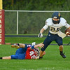 HALEY WARD | THE GOSHEN NEWS<br /> West Noble junior Draven Rasler attempts to tackle Fairfield junior Connor Kitson Friday at West Noble High School.