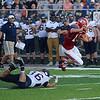 HALEY WARD | THE GOSHEN NEWS <br /> Fairfield linebacker Travis McCoy trips up Goshen quarterback C.J. Detweiler Friday at Goshen High School.