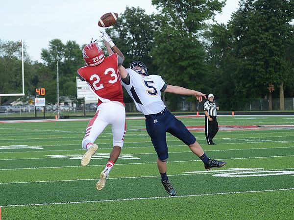 HALEY WARD   THE GOSHEN NEWS <br /> Fairfield safety Sylvanus Miller breaks up the pass to Goshen wide receiver Josuel Sanchez Friday at Goshen High School.