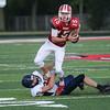 HALEY WARD | THE GOSHEN NEWS <br /> Fairfield safety Connor Kitson tackles Goshen quarterback C.J. Detweiler Friday at Goshen High School.