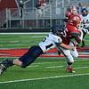 HALEY WARD | THE GOSHEN NEWS <br /> Fairfield safety Sylvanus Miller tackles Goshen running back Rummel Johnson Friday at Goshen High School.