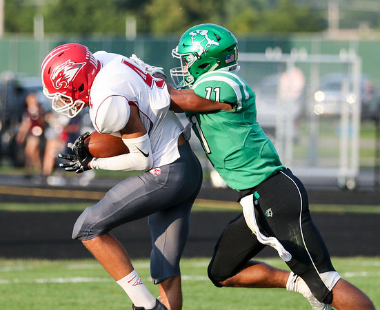 CHAD WEAVER   THE GOSHEN NEWS<br /> Goshen wide receiver Deven Love makes a catch for a touchdown while being defended by Concord defensive back Cedrick Mitchell during the second quarter of Friday night's game at Concord.