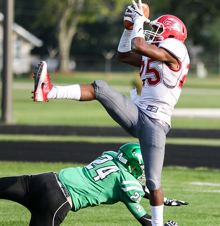 CHAD WEAVER | THE GOSHEN NEWS<br /> Goshen wide receiver Rummel Johnson makes an acrobatic catch during the first quarter of Friday night's game at Concord.