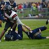 HALEY WARD | THE GOSHEN NEWS<br /> NorthWood wide receiver DeAndre Smart is brought down by Fairfield safties Brady Willard and Sylvanus Miller Friday at Fairfield Junior-Senior High School.