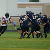 HALEY WARD | THE GOSHEN NEWS<br /> NorthWood quarterback Trey Bilinski runs through the gap during the game against Fairfield Friday at Fairfield Junior-Senior High School.