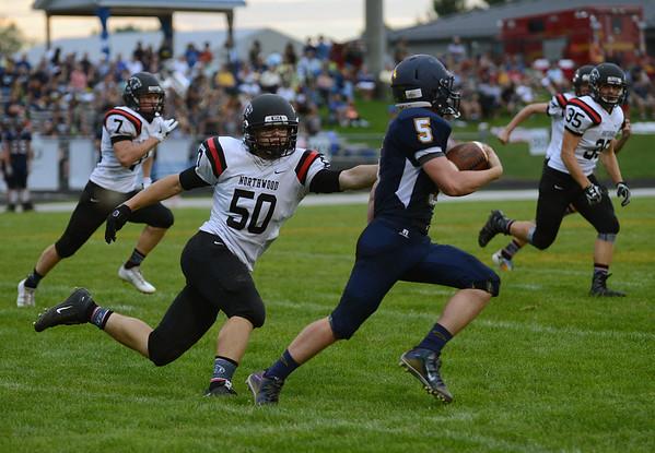 HALEY WARD   THE GOSHEN NEWS<br /> NorthWood linebacker Braden Mikel attempts to tackle wide receiver Sylvanus Miller Friday at Fairfield Junior-Senior High School.