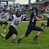 HALEY WARD | THE GOSHEN NEWS<br /> NorthWood linebacker Braden Mikel attempts to tackle wide receiver Sylvanus Miller Friday at Fairfield Junior-Senior High School.