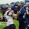 HALEY WARD | THE GOSHEN NEWS<br /> Fairfield safety Brady Willard tackles NorthWood running back Brayton Yoder Friday at Fairfield Junior-Senior High School.