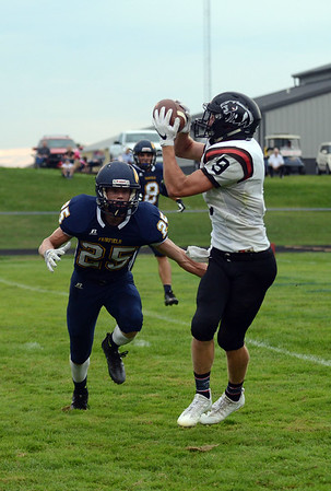 HALEY WARD   THE GOSHEN NEWS<br /> NorthWood wide receiver Bronson Yoder catches a pass while Fairfield safety Connor Kitson goes to tackle Friday at Fairfield Junior-Senior High School.