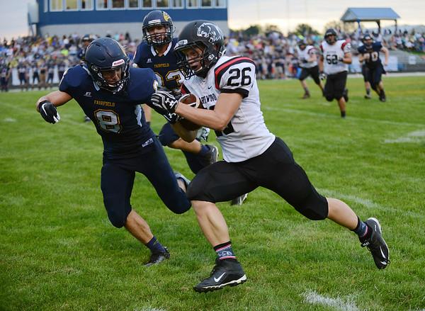 HALEY WARD | THE GOSHEN NEWS Fairfield safety Brady Willard goes to tackle NorthWood running back Brayton Yoder Friday at Fairfield Junior-Senior High School.