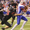 JAY YOUNG | THE GOSHEN NEWS <br /> NorthWood junior Brayton Yoder (26) hangs on for a ride as Indianapolis Roncalli quarterback Derek O'Connor pulls him into the endzone during the 4A state championship game Friday afternoon at Lucas Oil Stadium in Indianapolis.