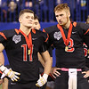JAY YOUNG | THE GOSHEN NEWS <br /> NorthWood captains Drew Minnich (11) and Trey Bilinski (3) watch the trophy ceremony following the 4A state championship game Friday afternoon at Lucas Oil Stadium in Indianapolis.