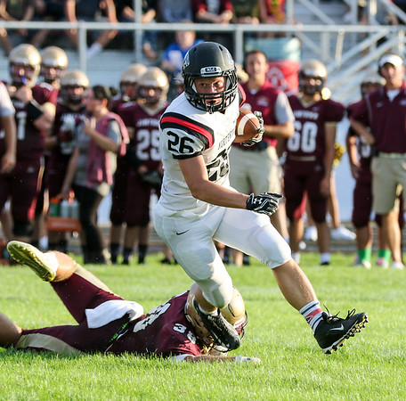 CHAD WEAVER | THE GOSHEN NEWS<br /> NorthWood running back Brayton Yoder eludes a backfield tackle by Jimtown's Nic Weiss during the first quarter of Friday night's game at Jimtown.