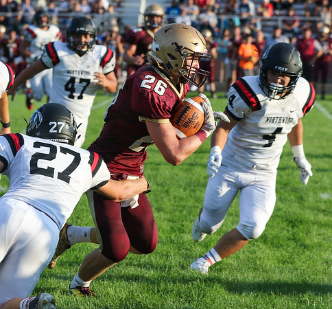 CHAD WEAVER   THE GOSHEN NEWS<br /> Jimtown running back Kenny Kerrn runs the ball during the first quarter of Friday night's game against NorthWood at Jimtown. Pursuing for NorthWood are Jake Stump (27), Will Ingle (47) and Jacob Chupp (4).