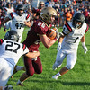 CHAD WEAVER | THE GOSHEN NEWS<br /> Jimtown running back Kenny Kerrn runs the ball during the first quarter of Friday night's game against NorthWood at Jimtown. Pursuing for NorthWood are Jake Stump (27), Will Ingle (47) and Jacob Chupp (4).