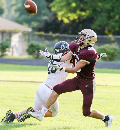 CHAD WEAVER | THE GOSHEN NEWS<br /> Jimtown receiver Andrew Siebert comes back for a deep pass while being defended by NorthWood defensive back Brayton Yoder during the first quarter of Friday night's game at Jimtown.