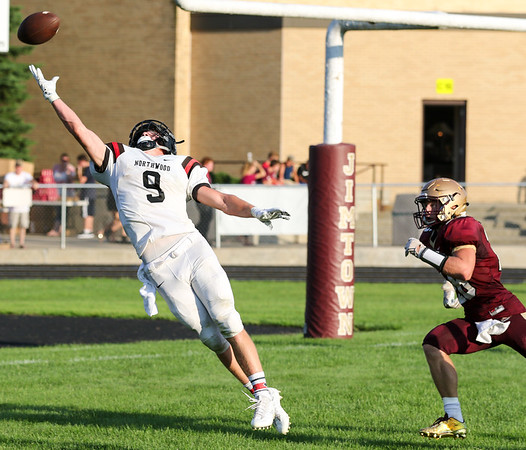 CHAD WEAVER | THE GOSHEN NEWS<br /> NorthWood wide receiver Bronson Yoder reaches for a deep pass in the end zone during the first quarter of Friday night's game at Jimtown. Defending for Jimtown is Kenny Kerrn.