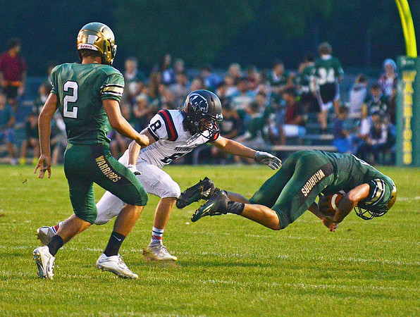 HALEY WARD   THE GOSHEN NEWS<br /> Wawasee Gavin Barker dives on the loose ball during a punt intended for NorthWood wide receiver Landen Gessinger as Wawasee wide receiver Dylan Hepler-Fink watches Friday at Wawasee High School.