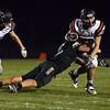 HALEY WARD | THE GOSHEN NEWS<br /> Wawasee linebacker Paul Mendoza tackles NorthWood running back Spencer Brubacher Friday at Wawasee High School.