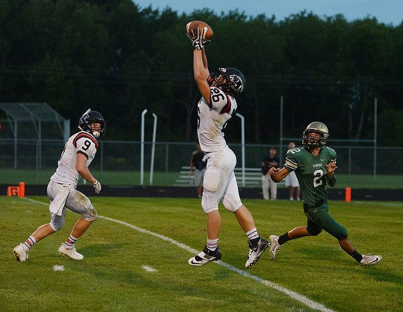 HALEY WARD | THE GOSHEN NEWS<br /> NorthWood defensive back Brayton Yoder intercepts the pass intended for Wawasee wide receiver Dylan Hepler-Fink Friday at Wawasee High School.
