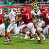 JAY YOUNG | THE GOSHEN NEWS<br /> A pack of Goshen High School defenders chase after Concord High School sophomore quarterback Ethan Cain (4)  during their game Friday night at GHS.