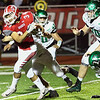 JAY YOUNG | THE GOSHEN NEWS<br /> Goshen High School senior running back Liam Morales (34) picks his way through the Concord High School defense during their game Friday night at GHS.