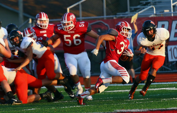 JAY YOUNG | THE GOSHEN NEWS<br /> Goshen High School senior Rene Gutierrez (37) breaks into the Warsaw secondary as he takes off downfield during their game Friday night at GHS.