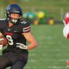 CHAD WEAVER | THE GOSHEN NEWS<br /> NorthWood running back Bronson Yoder looks to avoid Goshen defensive back Tyler Brinson during the first quarter of Friday night's game at NorthWood.