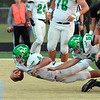 STACEY DIAMOND | THE GOSHEN NEWS<br /> Concord's Ethan Cain (4) gets propelled into the endzone for the Minutemen, with help from Brenden Boots (58), as Wawasee's Dalton Pearish (42) looks on.