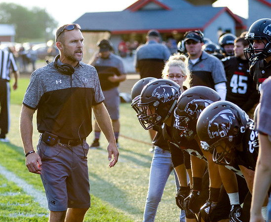 CHAD WEAVER | THE GOSHEN NEWS<br /> NorthWood head coach Nate Andrews talks to his player during a break in the action in the first quarter of Friday night's game against Goshen at NorthWood.