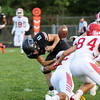 CHAD WEAVER | THE GOSHEN NEWS<br /> NorthWood quarterback Landen Gessinger has the ball knocked free by a Goshen defender near the goal line during the second quarter of Friday night's game at NorthWood.