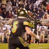 SAM HOUSEHOLDER | THE GOSHEN NEWS<br /> Northridge senior quarterback Payton Carson passes to senior receiver Cody Miller Friday during the sectional game against Bishop Dwenger.