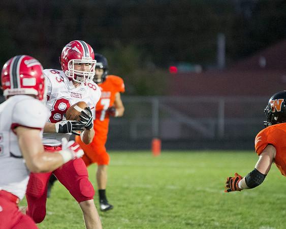 SAM HOUSEHOLDER | THE GOSHEN NEWS<br /> Goshen senior tight end Adam Pearson runs after the catch against Warsaw Friday. Teammate Brandon Scott, a junior fullback, looks to block on the play.
