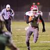 SAM HOUSEHOLDER   THE GOSHEN NEWS<br /> Goshen sophomore running back Jeff Stoll runs with the ball against Wawasee Friday.