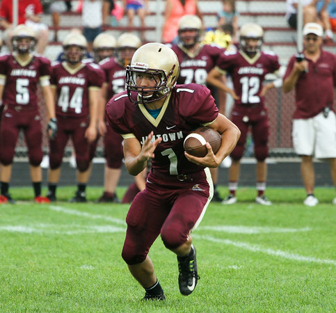 CHAD WEAVER   THE GOSHEN NEWS<br /> Jimtown sophomore Mason Castro looks for an opening after taking a handoff during the 1st quarter of Friday night's game against NorthWood at Jimtown.
