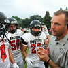 CHAD WEAVER | THE GOSHEN NEWS<br /> NorthWood head coach Nate Andrews talks with his defense during a timeout in the first half of Friday night's game at Jimtown.