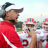 CHAD WEAVER | THE GOSHEN NEWS<br /> Goshen head coach Kyle Park talks with his team before the start of the 2nd quarter of Friday night's game at Elkhart Central.