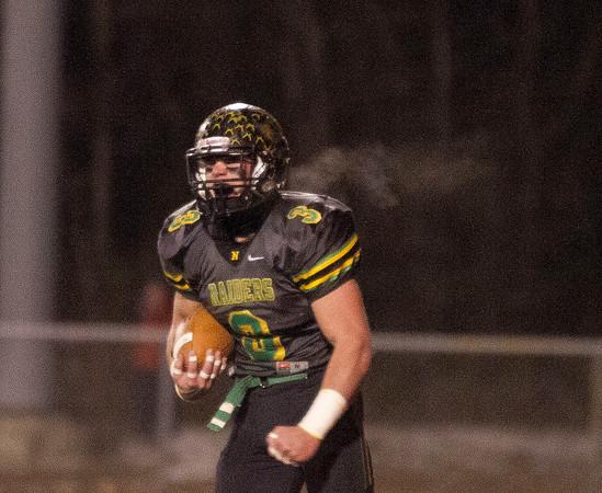 SAM HOUSEHOLDER   THE GOSHEN NEWS<br /> Northridge senior Cam Ridenour yells after scoring a touchdown Friday during the semistate game against New Prairie.