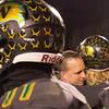 SAM HOUSEHOLDER | THE GOSHEN NEWS<br /> Northridge Raider coach Tom Wogoman hugs senior Christian Miller following a speech to the team Friday. The Raiders fell to New Prairie 28-10 in the semistate final game.