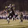 SAM HOUSEHOLDER | THE GOSHEN NEWS<br /> Northridge seniors Cam Ridenour, left (3) and Derek Woolsey (11) celebrate Ridenour's first quarter touchdown Friday during the semistate game against New Prairie.