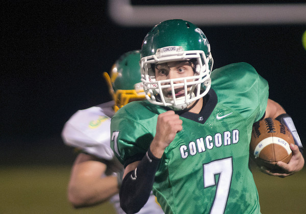 SAM HOUSEHOLDER | THE GOSHEN NEWS<br /> Concord quarterback Trevor Wilmore runs with the ball from Northridge defender Cam Ridenour during the game Friday at Concord High School.