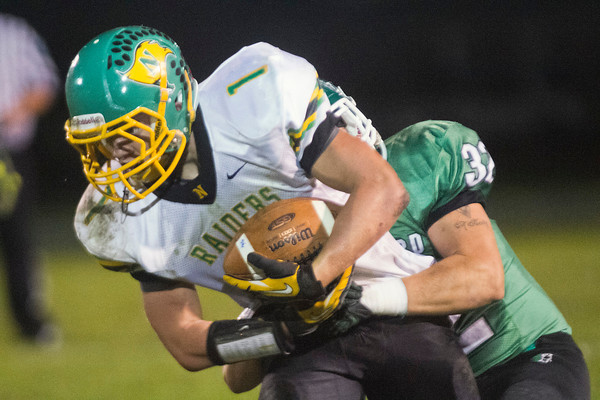 SAM HOUSEHOLDER | THE GOSHEN NEWS<br /> Northridge runnning back Craig Kasten is dragged down by Northridge linebacker Jake Kronk during the game Friday.