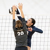Fairfield Falcons middle hitter Madisyn Steele (13) spikes the ball against Central Noble Cougars middle hitter Rachel Imhof (20) during Thursdays game at Fairfield Jr./Sr. High School in Benton.