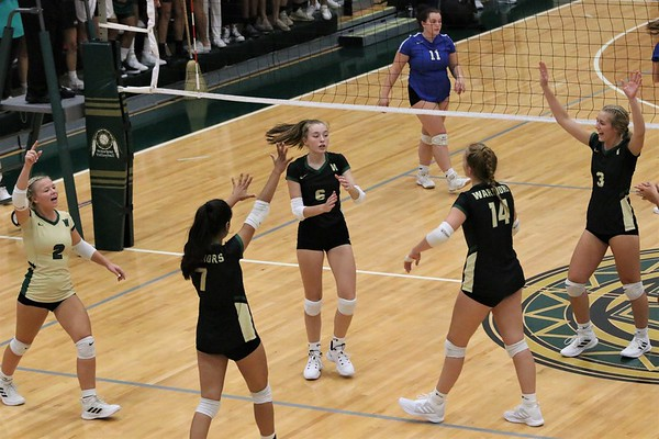 Wawasee huddles together after scoring a point during the second set of Thursday's game against Bethany Christian at Wawasee High School in Syracuse.