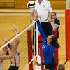 SAM HOUSEHOLDER   THE GOSHEN NEWS<br /> Bethany Christian senior Darienne Maust spikes the ball over the net at Westview's seniors Maria McCoy, left and Jennifer Hostetler.