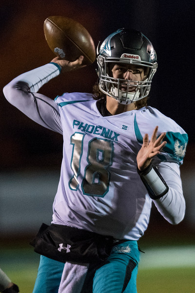 Wyatt Evertsen (18) quarterback of the Farmington finds a open receiver to pass to, against Bonneville High School, In Ogden on Friday October 4, 2019.