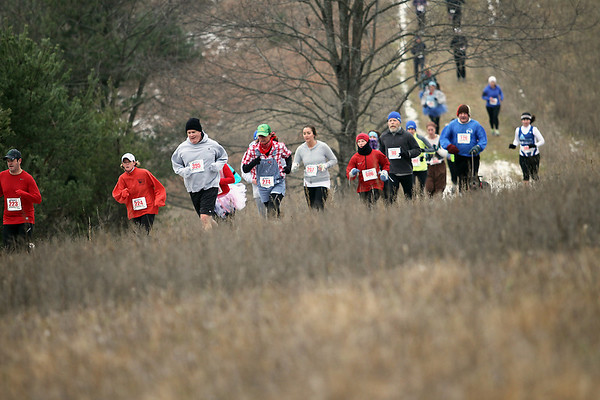 Record-Eagle/Jan-Michael Stump<br /> Runners make their way along the course in Saturday's Farmland 5k European Style XC race.