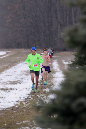 Record-Eagle/Jan-Michael Stump<br /> Runners make their way towards the finish line in Saturday's Farmland 5k European Style XC race.
