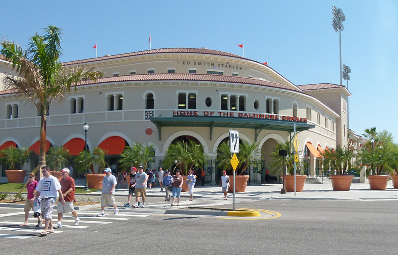 "This is a brand new stadium here in Sarasota.  It was built for the Baltimore Orioles spring training.  This was our first time to be in the staduim and it was for a special ""Father Henry day"".    He paid a price for that.  He was asked to wear an Orioles t-shirt, and for a die hard Philies fan, that was tough."